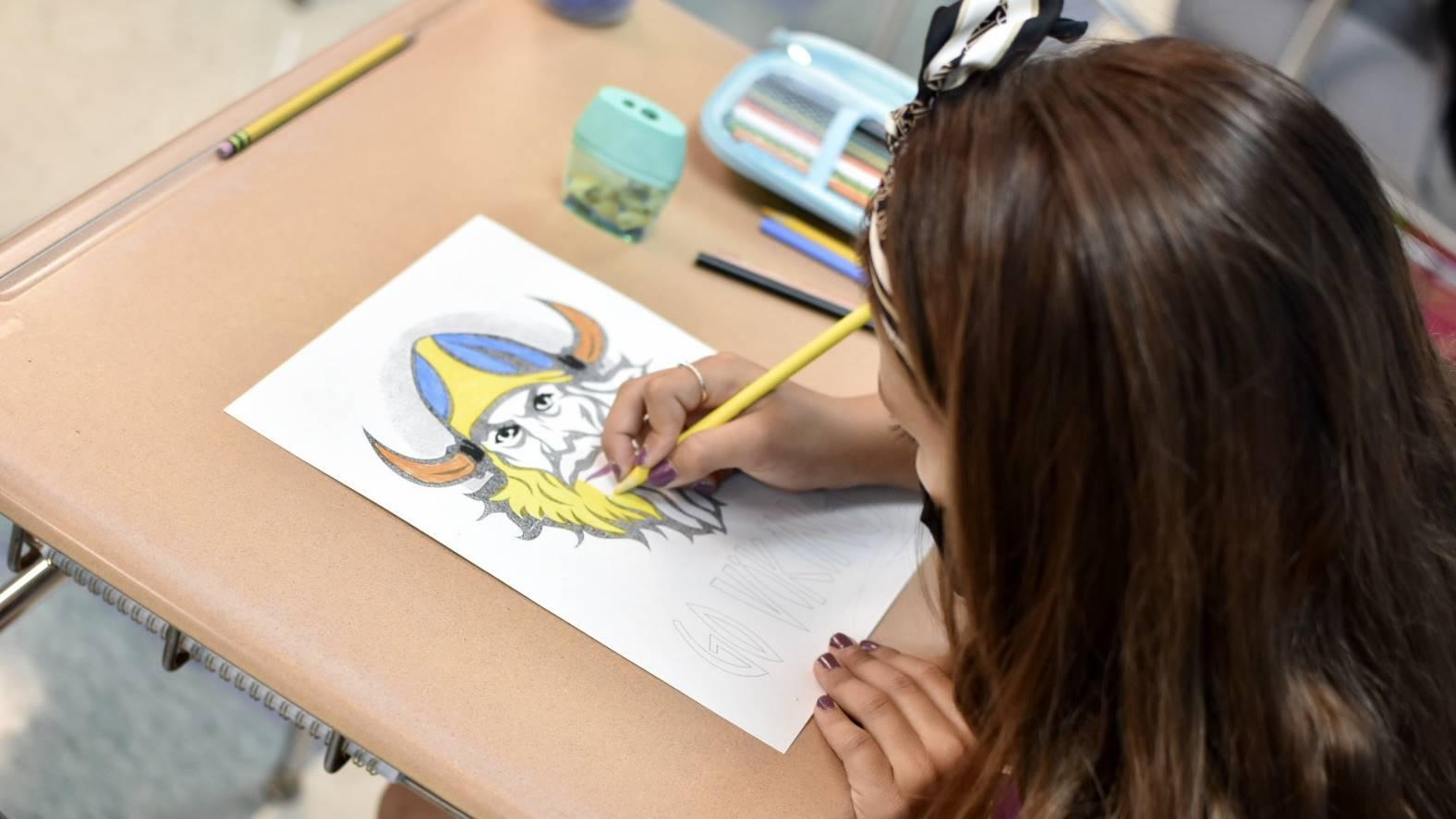 Girl Coloring a Viking Head