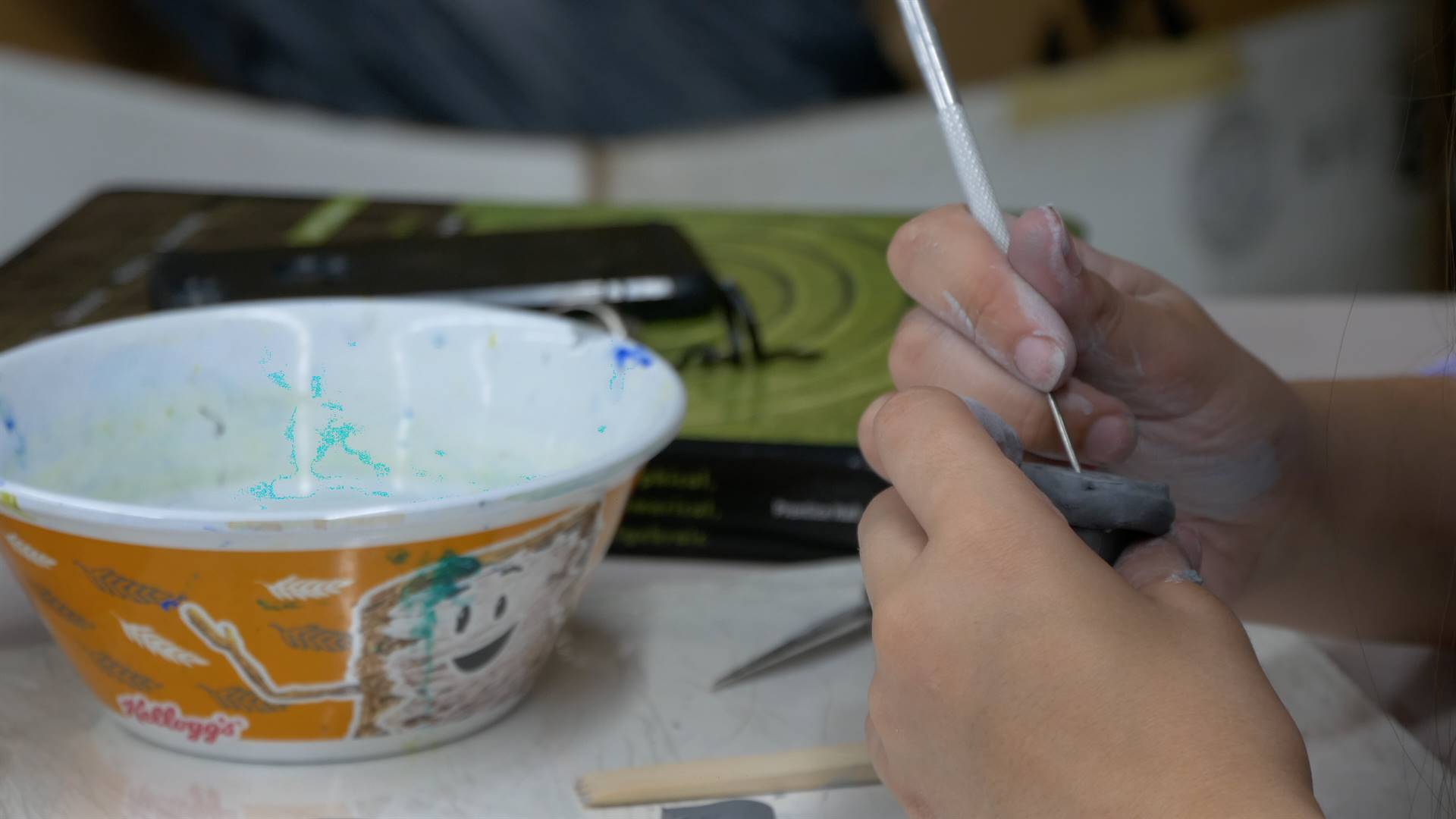 Student Working with Clay